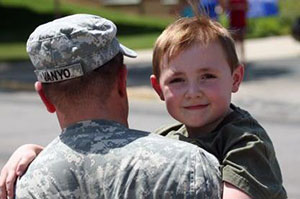 Veteran Services, Soldier Carrying his young Son
